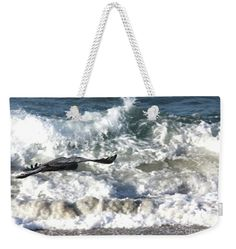 Pelican In Flight Weekender Tote Bag   by Gravityx9 Designs.  The tote bag is machine washable and includes cotton rope handle for easy carrying on your shoulder.  All totes are available for worldwide shipping and include a money-back guarantee. at Pixels and FineArtAmerica