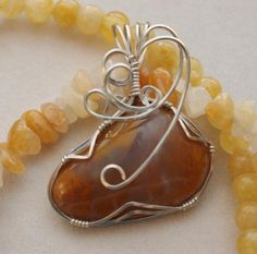 """Yellow Moss Agate Pendant on Handmade Artists' Shop. An outstanding piece of yellow moss agate, this is one gorgeous pendant. The mustard yellow color of the """"moss"""" suspended in clear agate is more unique than the more common green """"moss"""". Moss Agate does not contain organic materials rather it is formed when other minerals get …"""