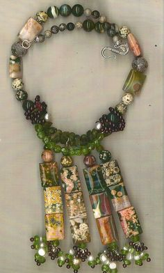 The idea of this design was for it to look like an artists canvas. The square ocean jasper are of superior quality & have amazing designs on them.