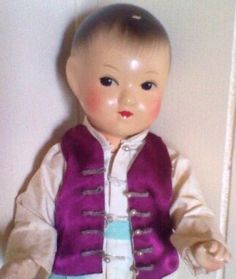 Japanese Samurai Boy Kimono Ichimatsu Go Fun Ningyo Doll. RARE FIND!: Add This Vintage Japanese Doll To Your Collection. I believe was created in the 1920's or early 1930's.This adorable boy has a soft well rounded face,an appealing gentle expression,and a sweet composure,he has a flesh colored complexion,painted hair,brown glass eyes,wide stroked eyebrows finely hand painted features. he wears a nice silk kimono and vest.That is in very good condition for the age of this doll.His silk blue…
