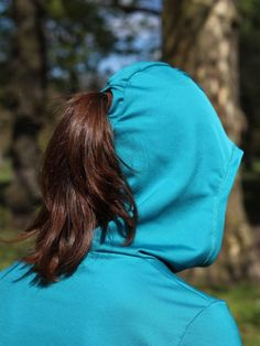 A teal french terry Tessellate Tee with ponytail hood