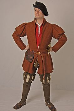 Costume made for a 1530s Groom of the Buckhounds in the household of Henry VIII. Full length slashed cross cut hose, silk camlet doublet and coat of broadcloth. Made to the specifications listed in the wardrobe accounts of 1538/1539. Made for JMD&Co at Hampton Court Palace. Photography by Henrietta Clare.