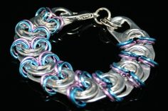 TABZ-blue and lavender    1 (one) Handcrafted 8.5 in soda / pop / pull tab bracelet    *recycled aluminum soda / pop tabs make this a lightweight piece of jewelry    *lobster clasp    *It will never rust, tarnish, fade or dull    *Can make in different sizes-just convo me    *A portion of each sale goes to support non-profit charities  $18.00