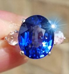 Royal Blue Sapphire of 5.55 cts. Ring  Blue and Peach