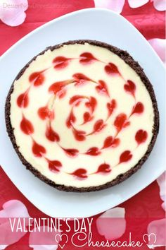 Valentines Day Cheesecake - Smooth lemon cheesecake, sweet strawberry hearts, with a crunchy chocolate crust. Delicious and romantic! DessertNowDinnerLater.com #cheesecake #valentinesday #dessert