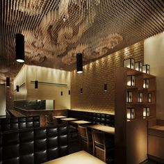 Swirling clouds of drumsticks cover the ceiling of this LA noodle restaurant: