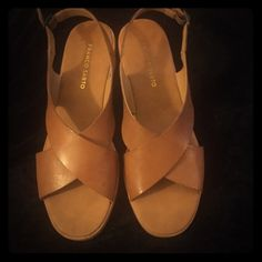 Franco Sarto tan leather criss cross flats These are in excellent used condition. Tan leather criss cross Franco Sarto flats. Size 10 Franco Sarto Shoes Sandals