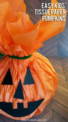Get the kids involved in Halloween and Fall decorating with these super easy kids' tissue paper pumpkins from SweetRoseStudio.com!