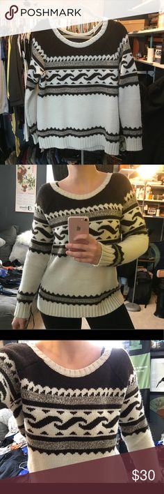American eagle sweater Wooly warm sweater. It's big and cozy. Will definitely keep you warm. I've never worn it anywhere. It isn't quite my style but it's very nice and was expensive (I got it as a gift). It's dark brown and off white. Not black. Brand new. American Eagle Outfitters Sweaters Crew & Scoop Necks