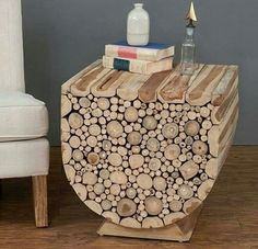 The distinctive U-shaped base on this Jeffan Augusta Side Table - Natural is comprised of artfully stacked teak wood branches cut to reveal the heartwood. Cool Woodworking Projects, Woodworking Guide, Custom Woodworking, Fine Woodworking, Diy Wood Projects, Wood Crafts, Diy Garage Shelves, Wood Working For Beginners, Diy Cabinets