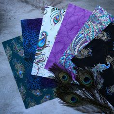 Ann Lauer has outdone herself yet again with an exquisite collection of Peacock prints. When you see the metallic accent against the deep shades of violet, turquoise and blue, your heart will flutter. Peacock Fabric, Peacock Print, Shades Of Violet, Flourish, Quilting Designs, Quilt Patterns, Pattern Design, Ann, Metallic