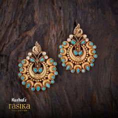 Rasika Chandbali earrings studded with synthetic turquoise colour stones made of pure silver.