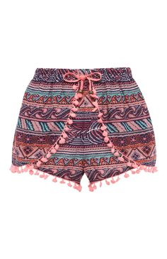 Pantalón corto con pompones y estampado azteca rosa