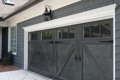 garage door trim provides great curb appeal for your exterior. Here are 10 garage door trim ideas for completing your house. Grey Garage Doors, Garage Door Trim, Carriage Garage Doors, Garage Door Design, Garage Door Repair, Garage Door Colors, Barn Doors, Paint Garage Doors, Cheap Garage Doors