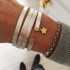 Stackin' em high with today's wrist party  . . . . #wristparty #armcandy #messagebangles #affirmations #handstamped #silverbangles #personalisedjewellery #mummystyle #viewfromthetop #smallbusiness #handmadejewellery