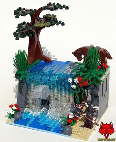 The Dungeon Behind the Falls by Justin Stebbins - Justin Stebbins of saber-scorpion.com created this vignette as an example for his Elemental Contest. The contest requires you to create something, preferably in LEGO, that centers on a partiucular element. The first contest is focused on water, hence this beautiful waterfall creation. The MOC features Joergen of Wulfgard standing guard while others inspect the dungeon hidden behind the waterfall. #LEGO #Minifigure #BrickWarriors #MOC #LEGOMOC