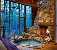 Hot tub in from of stone fireplace. Lots of awesome!