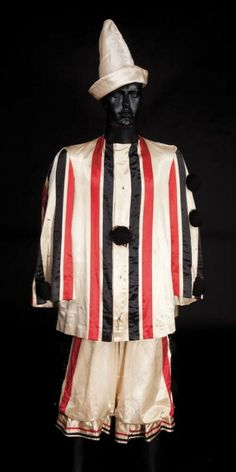 """James Cagney """"George M. Cohan"""" clown outfit from Yankee Doodle Dandy. (Warner Bros., 1942) Ivory satin clown top with black and red strips, black yarn buttons with matching pants and hat. Worn by James Cagney in his Academy Award-winning role as """"George M. Cohan"""" in """"The Belle of the Barber's Ball"""" number in Yankee Doodle Dandy."""