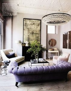Purple couch & gorgeous light fixture