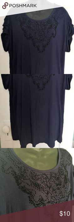 Navy Beaded Ruched Sleeve Lane Bryant Tee - 3X This lovely tee by Lane Bryant is made of 95% Viscose/5% Spandex and features a ton of stretch, ruched short sleeves, and a beaded neckline/bodice. Size is 22/24. Measures 50 inches in the chest, 48 inches in the waist, and it is 30 1/2 inches long from shoulder to bottom hem. Never worn. No tags. Navy blue. Lane Bryant Tops Tees - Short Sleeve