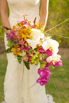 Now that's my idea of a tropical bouquet! Add another string of orchids and the bouquet will literally flow with you down the aisle. Destination wedding planner: www.destinationweddings.travel