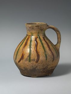 The Met - Jug with applied decoration - 13th century - British - Accession Number: 2014.583