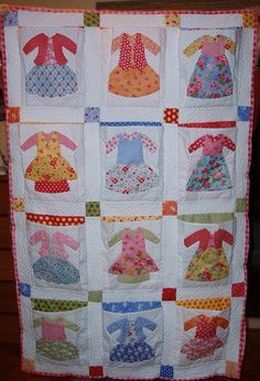 What a cute idea! You could use this idea in several ways. For instance as your child grows you can take pieces of the favorite outifts and recreate them on the quilt. Could be easily modified for little boys too....instead of skirts just make a pant.  Oh! the possibilites!