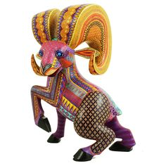 """Efrain Fuentes created this <strong>fabulous</strong> ramwoodcarving. Efrain is a member of the multi-talented Fuentes family of artists. His father is Epifanio and his siblings are Zeny, Ruby and Julia. This handsome ram is <strong>spectacularly</strong>painted and has great coloring. The carving is so """"alive"""" dynamic and fluid. Abeauty!"""