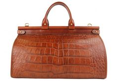 A rustic alligator carpetbag by Frank Clegg. There may be some drool on my keyboard.