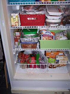 Organize your upright freezer with baskets {featured on Home Storage Solutions 101}