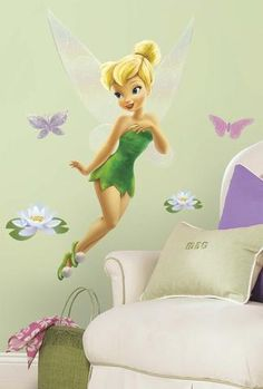 Bring home the magic of the Disney Fairies with this giant wall decal of Tinker…