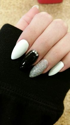Stilleto/Almond nails - white, black, glitter and rhinestones.