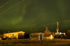 The northern lights fill the sky over the remote First Nations community of Attawapiskat. Attawapiskat is an isolated First Nation community located in northern Ontario, Canada, at the mouth of the Attawapiskat River on James Bay. On April 9, 2016, the community of approximately 2,000 people declared a state of emergency after being overwhelmed with attempted suicides, over 100 attempts in a 10-month period. Image by David Maurice Smith/Oculi. Canada, 2016.