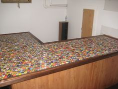 epic beer cap bar top - Home Brew Forums. DIY Ideas That Will Help You To Reuse Bottle Caps. Beer caps in coffee table, corks on community table. Bottle Cap Table, Bottle Cap Art, Bottle Cap Crafts, Beer Bottle, Cafe Bar, Bungalow, Reuse Bottles, Home Brewery, Beer Caps