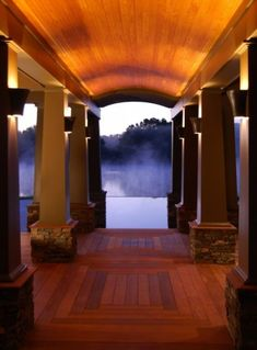 A strong architectural deck leading to an infinity pool overlooking a beautiful, ethereal marsh