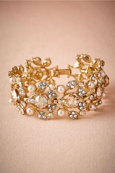 "Gilded cuff bracelet: Has your bride been talking about how she is in need of a ""statement accessory"" for her wedding day look? This gilded cuff bracelet might just be exactly what she has in mind. She can wear it on the big day and then pull it out of her jewelry box for future special events."