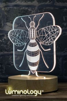 An original gift for those 🐝 #decoaddicts. This amazing Bee #3dillusionlamp is availabile in our online store 👆 £30 - Trouvez cette 3D ILLUSION #lampe abeille 🐝 sur notre site web 👆 35€ #lamps #lamps3d #chambredeco #decoration #luminologystudio 3d Light, Living Room Lighting, Illusions, Lamps, Bee, Gift Ideas, Decoration, Store, Amazing