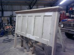 headboard diy; think I might take my old door from the bedroom and turn it into the headboard.