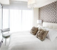 What to hang above the bed: Wallpaper or Stencil. A repeating pattern in wallpaper stands on its own and rarely needs further embellishment, although a mirror on top looks great too! Pair coordinated bedding to complete the look.