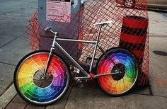 paint sample cards make bicycles into rainbow wheels! YES PLEASE.