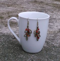 Toremore Crafts - bronze foliage charms with red fire polished crystal glass beads