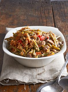 Try this slow cooker green bean casserole that features the classic components—green beans, cream of mushroom soup, garlic, mushrooms—plus smoked Gouda for a modern twist. #slowcookersidedish #thanksgivingrecipe #thanksgivingsidedish #potluckthanksgivingrecipe #bhg Healthy Christmas Recipes, Stuffing Recipes For Thanksgiving, Thanksgiving Side Dishes, Slow Cooker Recipes, Crockpot Recipes, Cooking Recipes, Keto Recipes, Chicken Recipes, Healthy Green Bean Casserole