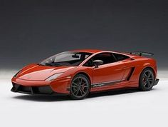 Lamborghini Gallardo LP570-4 Superleggera Diecast Model Car by AUTOart 74655 This Lamborghini Gallardo LP570-4 Superleggera Diecast Model Car is Andromeda Red and features working steering, suspension, wheels and also opening bonnet, boot with engine, doors. It is made by AUTOart and is 1:18 scale (approx. 24cm / 9.4in long). 2010 Lamborghini Gallardo, Lamborghini Models, Diecast Model Cars, Scale Models, Dream Cars, Mens Fashion, Vehicles, Engine, Wheels
