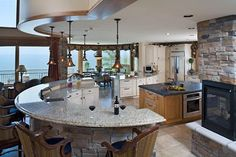 dreamy kitchen; curves and stone, windows and incredible view