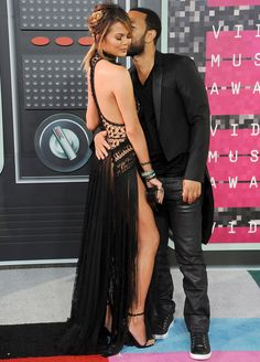 12 Star Couples Who Aren't Afraid of a Little PDA on the Red Carpet - CHRISSY TEIGEN AND JOHN LEGEND AT THE MTV VIDEO MUSIC AWARDS, AUGUST 2015.  - from InStyle.com