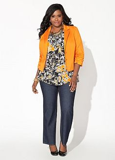 This picture is a good example of finding a flowy shirt with a great pattern and then making the fit work for you by adding a smaller fitting and structured jacket on top. The jacket pulls the waist of the shirt in which define and accents your waist. Her pants are a tad short for my taste though. I like the hem of the pants to at least rest on the top of the foot. JR