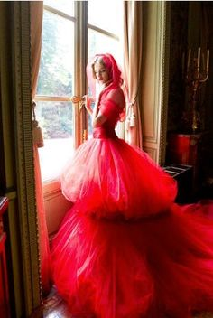 Me, wearing a Valentino, pouffed and  pretty, red/pink, evening gown...