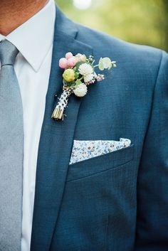 groom with polka dot and floral accents | katie mitchell photography