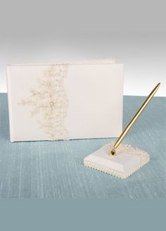 "Ivory Guest Book with attached Pen adorned with beaded lace.  Space for 600 signatures & thoughts.  Available online and in stores in Ivory. There are 17 total pages in this guest book with 234 lines for your guest's signature or well wishes. Guest Book measures 9 1/2"" x 6 1/2"" and pen stand is 4"" square."