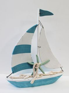 "Fun and colorful blue and white sailboat with green starfish measures 14 1/2"" x 12""."